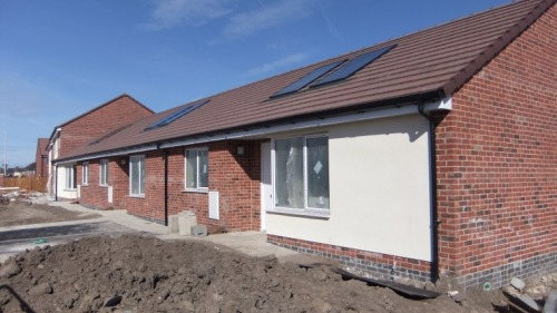 New_houses_under_construction_on_Town_Meadow_Lane_Moreton_2